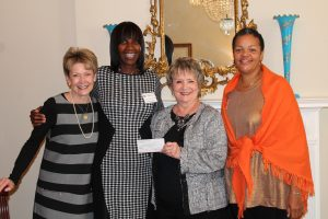 Rigby Duncan, Alpha Xi Delta and 2016-2017 AAPA President, presenting Lucy Hall, daughter of Mary Hall and founder of Mary Hall Freedom House, a check for $1,000.00. Pictured L to R: Carol Harman, Delta Gamma and AAPA Philanthropy Committee Chair; Lucy Hall, daughter of Mary Hall and founder of Mary Hall Freedom House; Rigby Duncan, Alpha Xi Delta and 2016-2017 AAPA President; Kimberly McClee, Operations Director of Mary Hall Freedom House